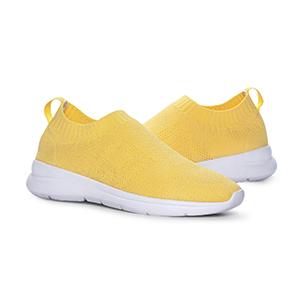 Bild på gula skor med vit sula